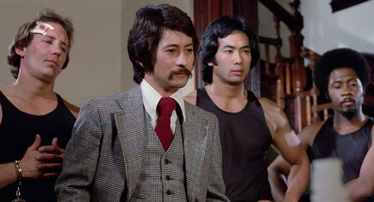 Michael Chong, Joshua Johnson, and Ron Marchini in Death Machines (1976)