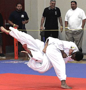 A perfect judo throw executed at the tournament.
