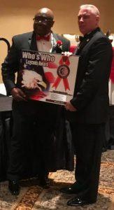 Michael Munyon receive Who's Who Plaque