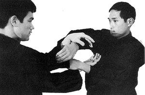 "Ted Wong conducts ""sticking hands"" practice with Bruce Lee"