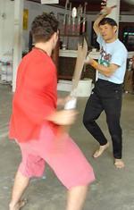 Kru Pedro Villaobos and the Ajarn Thai Sword Master practice sword