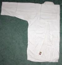 Folding the Gi: gi jacket folded one arm on top