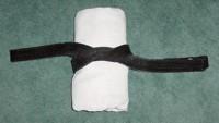 Folding the Gi: jacket rolled on obi one knot