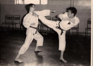 Murikami kicks Manning.