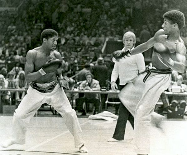 Fred Miller (lft) Chester Miller (rt) and Chuck Norris as referee. Karate Master Morio Higaonna