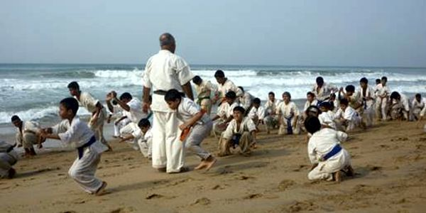 Practicing martial arts barefoot on the sand