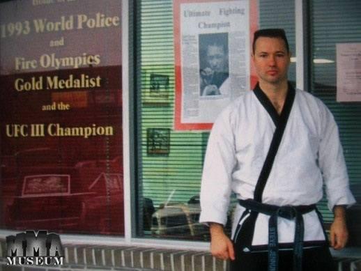 Keith Hackney in front of his martial arts school.