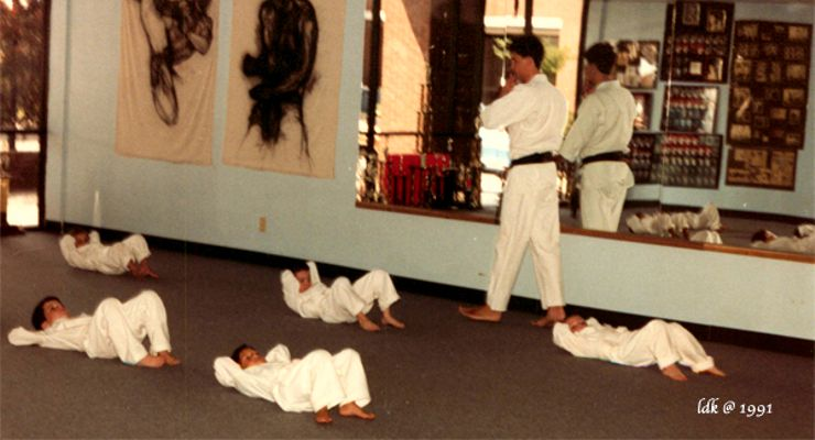 Sensei Mitch Coslet martial arts class doing situps.