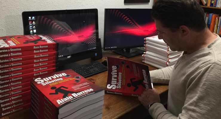 Alain Burrese signing his Survive a Shooting Books