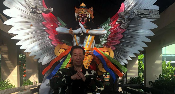 GM Samuel Kwok in front of the mascot for the 1st Bali International Kungfu Championships