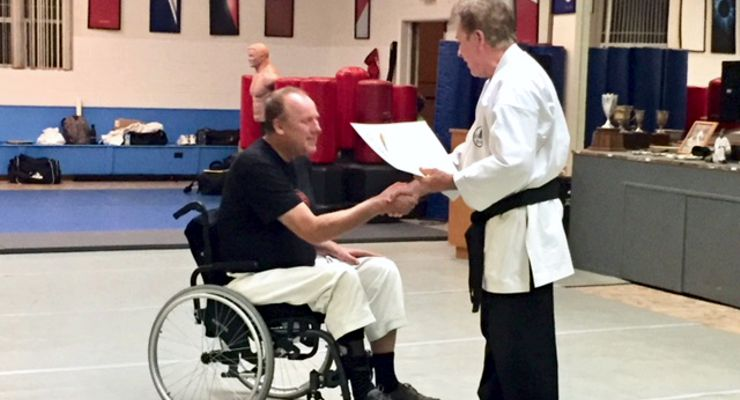 Martial Arts instructor Peters Grootenhuis receives his Sandan or 3rd degree Balck Belt.