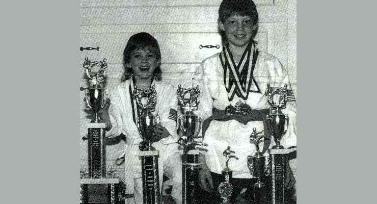 Hermitage School Students Colt and Stephen Sanders with karate trophies and medals.