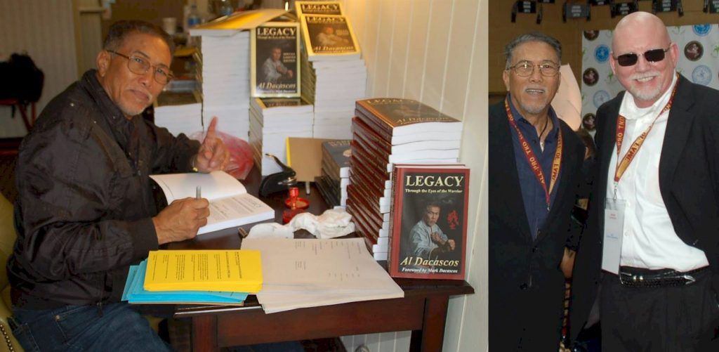 Al Dacasco signing copies of Legacy and Bohdi Sanders being honored at the All Pro TKD event.